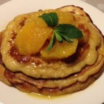 Zesty orange pancakes with honey and orange sauce